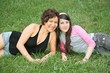 mother and teen daughter on grass