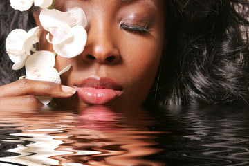 Beautiful black woman with orchid