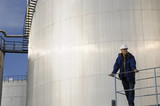 oil storage tanks and engineer poster