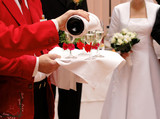 Waiter pouring champagne on a wedding poster