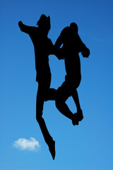 Jumping against blue sky