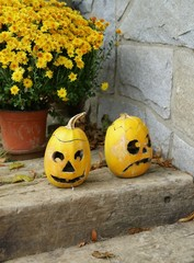Two yellow pumpkin on stairs - Halloween
