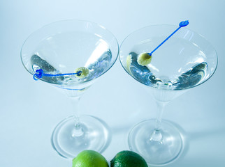 Cocktail glasses with olives closeup