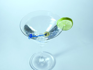 Martini in glass with lime and olive