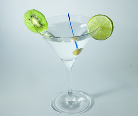 Martini glass with olive, lime and kiwifruit