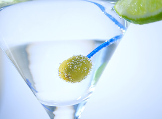 Green olive in martini