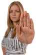 Business women with hand up saying STOP