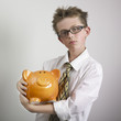 Boy hugging piggy bank