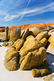Stunning granite boulders on beach poster