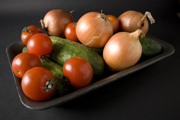 Tomatoes and onion and cucumbers