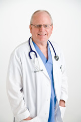 smiling doctor in scrubs and lab coat