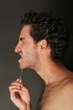 Handsome man with tweezers poster
