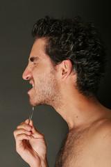 Handsome man with tweezers
