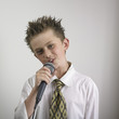 Boy singing with microphone