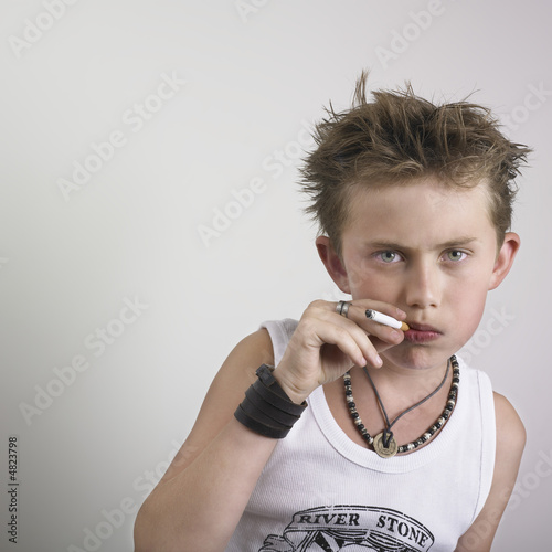 Young boy with cigarette