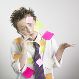 Boy covered in sticky notes