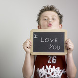 Boy holding i love you sign poster