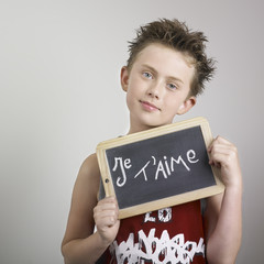 Boy with je t'aime sign
