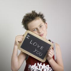 Boy holding chalkboard