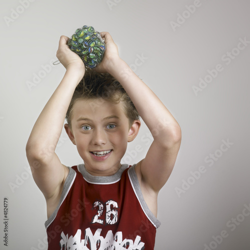 Boy holding toy over head