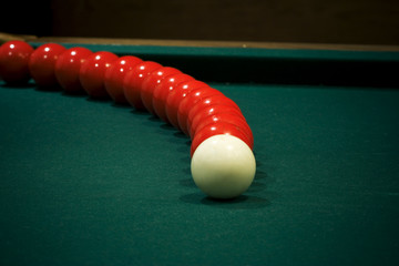 White cue balls with arcing red pool balls