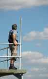 man on observation platform poster