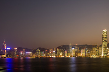 Skyline of Victoria Harbour in Hong Kong at dusk