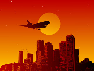 Airplane fly in the sunset in a town