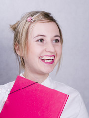 smiling woman in the white shirt with pink folder