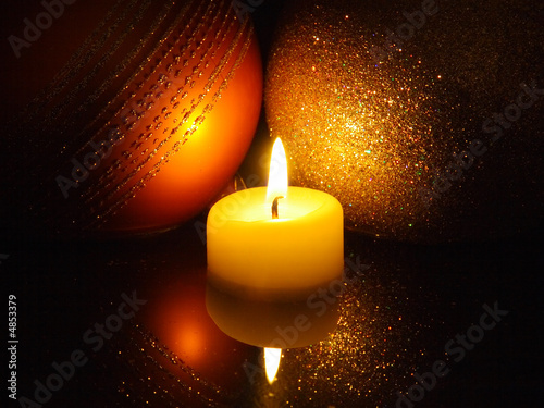 Christmas candle lights decoration with reflection in the water