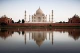 Taj Mahal reflected in river at twilight poster