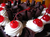 Delicious chocolate cake with maraschino cherries