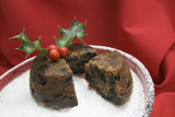 Christmas pudding with a slice cut away with holly poster