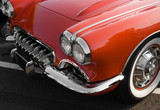Classic red American sports car with chrome trim poster