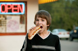 Boy Eating a Footlong Hot Dog