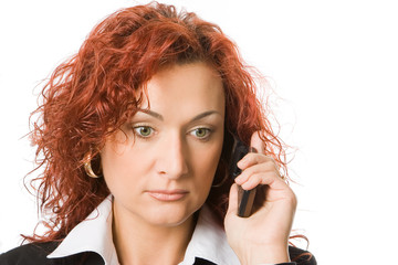 attractive young redheaded woman calling by cellular phone