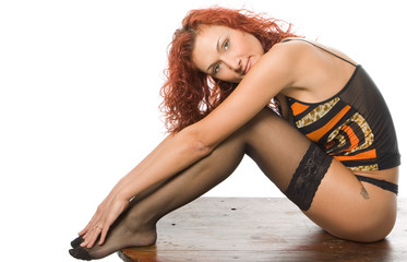 beauty redheaded woman in lingerie sit on old wooden board