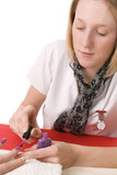 Young professional woman manicurist painting nails poster