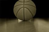 Closeup of a basketball on a hardwood court poster