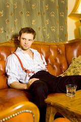 Handsome man sitting on a sofa