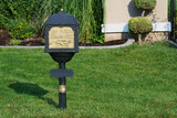 Classic Mailbox on Lush Green Grass Lawn with Topiary Shrub. poster
