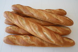 Several baguettes direct from the bakery poster