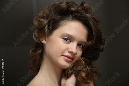 Beautiful teen girl with brown curly hair