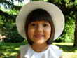 Smiling little girl in summer hat