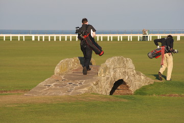 golf players at st andrews swilken bridge