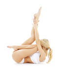 Fototapety fit blond in white underwear practicing yoga