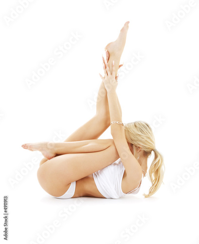 fit blond in white underwear practicing yoga