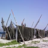 Fishing nets drying on racks poster