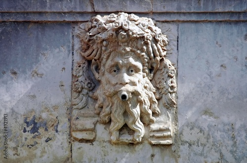 artistic relief of the head on the fountain in Alhambra, Spain