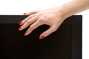 Woman hand on lcd-tv screen